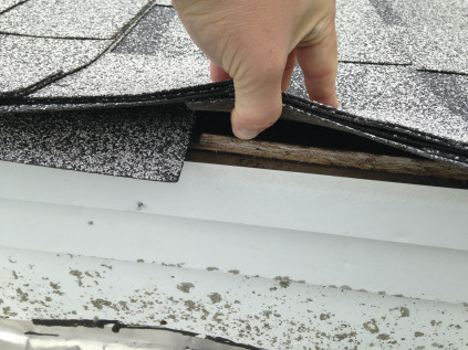The roofer on this particular job did not install any drip-edge flashing, and you can see how the edge of the sheathing has weathered from exposure to water.