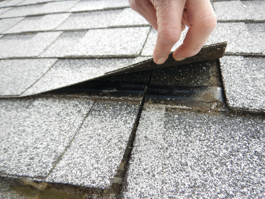 When the author inspected the project, no nails were evident at the ends of many of the shingles.
